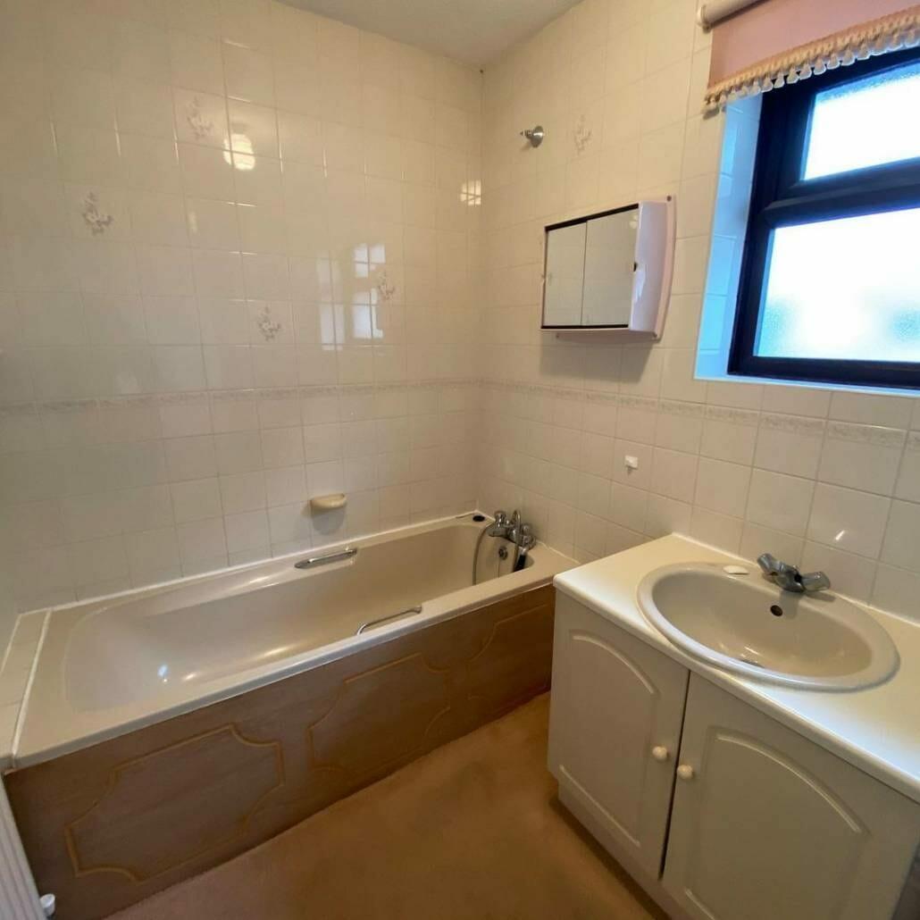 Old bathroom suite with bath